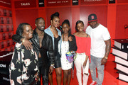 """Elijah Kelley (2nd L), Justine Skye (3rd L), and Thomas Jones (R) of BET's """"Tales"""" pose with fans at World Of BET during the BET Experience Fan Fest at Los Angeles Convention Center on June 22, 2019 in Los Angeles, California."""