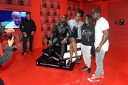 """Elijah Kelley (L), Justine Skye (2nd L), and Thomas Jones (R) of BET's """"Tales"""" pose with a fan at World Of BET during the BET Experience Fan Fest at Los Angeles Convention Center on June 22, 2019 in Los Angeles, California."""