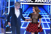 (L-R) Ross Lynch and Kiernan Shipka walk onstage during the 2019 Billboard Music Awards at MGM Grand Garden Arena on May 01, 2019 in Las Vegas, Nevada.