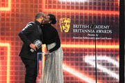 (L-R) Jordan Peele accepts the John Schlesinger Britannia Award for Excellence in Directing Presented by Cunard from Lupita Nyong'o onstage during the 2019 British Academy Britannia Awards presented by Jaguar Land Rover and American Airlines at The Beverly Hilton Hotel on October 25, 2019 in Beverly Hills, California.