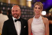 Nathan Jones of the Demons and his wife Jerri Jones and arrive ahead of the 2019 Brownlow Medal at Crown Palladium on September 23, 2019 in Melbourne, Australia.