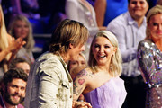 Keith Urban (L) and Julia Michaels walk through the audience to accept an award during the 2019 CMT Music Awards - Backstage & Audience at Bridgestone Arena on June 05, 2019 in Nashville, Tennessee.