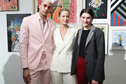 Miles Chamley-Watson (L)  and Carolyn Murphy (C) attend the 2019 Chefs For Kids' Cancer at Metropolitan Pavilion Metro West on March 12, 2019 in New York City.