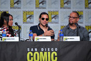 .(L-R) Candice Patton, Carlos Valdes, and Eric Wallace speak at 'The Flash' Special Video Presentation and Q&A during 2019 Comic-Con International at San Diego Convention Center on July 20, 2019 in San Diego, California.