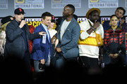 (L-R) Kevin Feige, Jeremy Renner, Mahershala Ali, Brian Tyree Henry, Tessa Thompson and Chris Hemsworth speak at the Marvel Studios Panel during 2019 Comic-Con International at San Diego Convention Center on July 20, 2019 in San Diego, California.