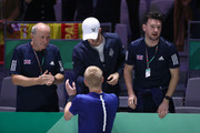 Kyle Edmund of Great Britain celebrates Andy Murray of Great Britain following his victory in his semi-final singles match against Feliciano Lopez of Spain during Day Six of the 2019 Davis Cup at La Caja Magica on November 23, 2019 in Madrid, Spain.