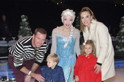 """(L-R)  Armie Hammer, Ford Armand Douglas Hammer, """"Elsa,"""" Harper Grace Hammer, and Elizabeth Chambers pose for portrait at 2019 Disney On Ice """"Mickey's Search Party"""" at Staples Center on December 13, 2019 in Los Angeles, California."""
