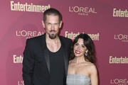 (L-R) Steve Howey and Sarah Shahi attend the 2019 Entertainment Weekly Pre-Emmy Party at Sunset Tower on September 20, 2019 in Los Angeles, California.
