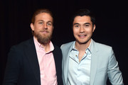 Charlie Hunnam and Henry Golding Photos Photo