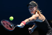 Angelique Kerber of Germany stretches to play a backhand to Garbine Muguruza of Spain during day two of the 2019 Hopman Cup at RAC Arena on December 30, 2018 in Perth, Australia.