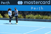 Serena Williams and Frances Tiafoe of the United States talk while practicing during day two of the 2019 Hopman Cup at RAC Arena on December 30, 2018 in Perth, Australia.