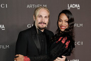 (L-R) Marco Perego and Zoe Saldana, wearing Gucci, attend the 2019 LACMA Art + Film Gala Presented By Gucci at LACMA on November 02, 2019 in Los Angeles, California.