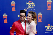(L-R) Daniel Levy and Annie Murphy attend the 2019 MTV Movie and TV Awards at Barker Hangar on June 15, 2019 in Santa Monica, California.