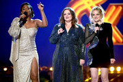 (L-R) Tiffany Haddish, Melissa McCarthy and Elisabeth Moss speak onstage during the 2019 MTV Movie and TV Awards at Barker Hangar on June 15, 2019 in Santa Monica, California.