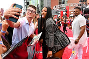 Megan Thee Stallion poses for a selfie with a fan during the 2019 MTV Video Music Awards at Prudential Center on August 26, 2019 in Newark, New Jersey.