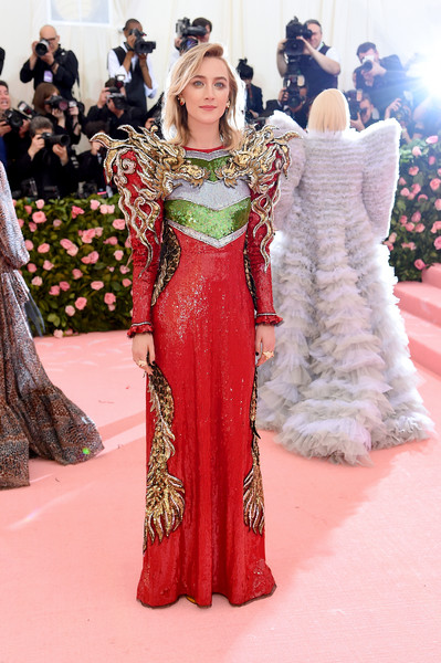 Saoirse Ronan looked fantastic in a fully sequined Gucci gown with dragon-embellished shoulders at the 2019 Met Gala.