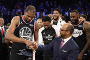 Kevin Durant #35 of the Golden State Warriors and Team LeBron is awarded the MVP trophy after their 178-164 win over Team Giannis during the NBA All-Star game as part of the 2019 NBA All-Star Weekend at Spectrum Center on February 17, 2019 in Charlotte, North Carolina. NOTE TO USER: User expressly acknowledges and agrees that, by downloading and/or using this photograph, user is consenting to the terms and conditions of the Getty Images License Agreement. Mandatory Copyright Notice: Copyright 2019 NBAE