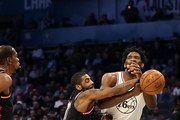 Joel Embiid #21 of the Philadelphia 76ers and Team Giannis is pressed as he drives against Kyrie Irving #11 of the Boston Celtics and Team LeBron the third quarter during the NBA All-Star game as part of the 2019 NBA All-Star Weekend at Spectrum Center on February 17, 2019 in Charlotte, North Carolina.  NOTE TO USER: User expressly acknowledges and agrees that, by downloading and/or using this photograph, user is consenting to the terms and conditions of the Getty Images License Agreement.
