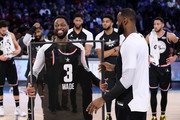 Dwyane Wade #3 of Team LeBron receives commemorative All-Star jersey from LeBron James #23 after the NBA All-Star game as part of the 2019 NBA All-Star Weekend at Spectrum Center on February 17, 2019 in Charlotte, North Carolina. Team LeBron won 178-164. NOTE TO USER: User expressly acknowledges and agrees that, by downloading and/or using this photograph, user is consenting to the terms and conditions of the Getty Images License Agreement. Mandatory Copyright Notice: Copyright 2019 NBAE