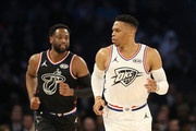 Russell Westbrook #0 (R) of the Oklahoma City Thunder and Team Giannis reacts as Dwyane Wade #3 (L) of the Miami Heat and Team LeBron looks on in the second quarter during the NBA All-Star game as part of the 2019 NBA All-Star Weekend at Spectrum Center on February 17, 2019 in Charlotte, North Carolina.  NOTE TO USER: User expressly acknowledges and agrees that, by downloading and/or using this photograph, user is consenting to the terms and conditions of the Getty Images License Agreement. Mandatory Copyright Notice: Copyright 2019 NBAE