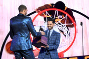 (L-R) Rudy Gobert accepts the Kia NBA Defensive Player of the Year award from Hasan Minhaj onstage during the 2019 NBA Awards presented by Kia on TNT at Barker Hangar on June 24, 2019 in Santa Monica, California.