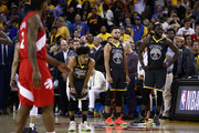 Quinn Cook #4, Stephen Curry #30 and Draymond Green #23 of the Golden State Warriors react late in the game against the Toronto Raptors during Game Six of the 2019 NBA Finals at ORACLE Arena on June 13, 2019 in Oakland, California. NOTE TO USER: User expressly acknowledges and agrees that, by downloading and or using this photograph, User is consenting to the terms and conditions of the Getty Images License Agreement.