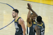 Andre Iguodala #9 of the Golden State Warriors celebrates with Draymond Green #23 and Klay Thompson #11 against the Toronto Raptors during Game Six of the 2019 NBA Finals at ORACLE Arena on June 13, 2019 in Oakland, California. NOTE TO USER: User expressly acknowledges and agrees that, by downloading and or using this photograph, User is consenting to the terms and conditions of the Getty Images License Agreement.