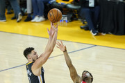 Klay Thompson #110 of the Golden State Warriors attempts a jump shot against the Toronto Raptors in the second half during Game Six of the 2019 NBA Finals at ORACLE Arena on June 13, 2019 in Oakland, California. NOTE TO USER: User expressly acknowledges and agrees that, by downloading and or using this photograph, User is consenting to the terms and conditions of the Getty Images License Agreement.