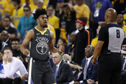 Quinn Cook #4 of the Golden State Warriors reacts to referee Marc Davis #8 in the first half against the Toronto Raptors during Game Six of the 2019 NBA Finals at ORACLE Arena on June 13, 2019 in Oakland, California. NOTE TO USER: User expressly acknowledges and agrees that, by downloading and or using this photograph, User is consenting to the terms and conditions of the Getty Images License Agreement.