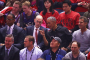 NBA Commissioner Adam Silver and former President of the United States, Barack Obama speak in the first half during Game Two of the 2019 NBA Finals between the Golden State Warriors and the Toronto Raptors at Scotiabank Arena on June 02, 2019 in Toronto, Canada.  NOTE TO USER: User expressly acknowledges and agrees that, by downloading and or using this photograph, User is consenting to the terms and conditions of the Getty Images License Agreement.
