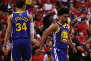 Quinn Cook #4 and Shaun Livingston #34 of the Golden State Warriors celebrate the play against the Toronto Raptors in the second half during Game Two of the 2019 NBA Finals at Scotiabank Arena on June 02, 2019 in Toronto, Canada.  NOTE TO USER: User expressly acknowledges and agrees that, by downloading and or using this photograph, User is consenting to the terms and conditions of the Getty Images License Agreement.
