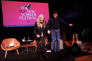 Patti Smith and David Remnick take a bow on stage during the 2019 New Yorker Festival on October 11, 2019 in New York City.