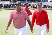 Tiger Woods and Patrick Reed Photos Photo