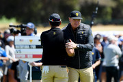 Captain Ernie Els of South Africa and the International team greets Hideki Matsuyama of Japan and the International team on the 17th hole during Thursday four-ball matches on day one of the 2019 Presidents Cup at Royal Melbourne Golf Course on December 12, 2019 in Melbourne, Australia.