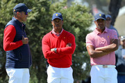 Matt Kuchar of the United States team, Playing Captain Tiger Woods of the United States team and Tony Finau of the United States team look on during Thursday four-ball matches on day one of the 2019 Presidents Cup at Royal Melbourne Golf Course on December 12, 2019 in Melbourne, Australia.