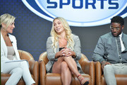 (L-R) Charissa Thompson, Charlotte Flair and Reggie Bush of Fox Sports speak during the Fox segment of the 2019 Summer TCA Press Tour at The Beverly Hilton Hotel on August 7, 2019 in Beverly Hills, California.