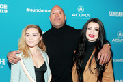 "(L-R) Florence Pugh, Dwayne Johnson, and Paige attend the surprise screening of ""Fighting With My Family"" during the 2019 Sundance Film Festival at The Ray on January 28, 2019 in Park City, Utah."