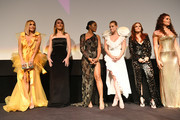 "(L-R) Jennifer Lopez, Julia Stiles, Keke Palmer, Lili Reinhart , Madeline Brewer and Trace Lysette attend the ""Hustlers"" premiere during the 2019 Toronto International Film Festival at Roy Thomson Hall on September 07, 2019 in Toronto, Canada."