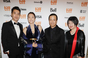 "(L-R) Mark Chao, Gong Li, Lou Ye and Ma Yingli attend the ""Saturday Fiction"" premiere during the 2019 Toronto International Film Festival at Winter Garden Theatre on September 07, 2019 in Toronto, Canada."