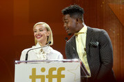 (L-R) Sarah Gadon and Stephan James speak onstage during the 2019 Toronto International Film Festival TIFF Tribute Gala at The Fairmont Royal York Hotel on September 09, 2019 in Toronto, Canada.