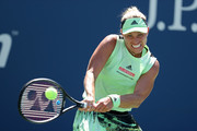 Angelique Kerber of Germany returns a shot during her women's singles first round match against Kristina Mladenovic of France during day one of the 2019 US Open at the USTA Billie Jean King National Tennis Center on August 26, 2019 in the Flushing neighborhood of the Queens borough of New York City.