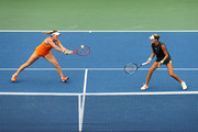 Timea Babos (L) of Hungary and Kristina Mladenovic of France in action during their Women's Doubles third round match against Yulia Putintseva of Kazakhstan and Anna Kalinskaya of Russia on day eight of the 2019 US Open at the USTA Billie Jean King National Tennis Center on September 02, 2019 in Queens borough of New York City.