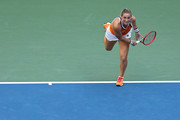 Timea Babos of Hungry and Kristina Mladenovic of France serve during their Women's Doubles quarterfinal match against Ashleigh Barty of Australia and Victoria Azarenka of Belarus on day nine of the 2019 US Open at the USTA Billie Jean King National Tennis Center on September 03, 2019 in the Queens borough of New York City.