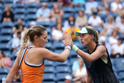 Timea Babos of Hungry and Kristina Mladenovic of France celebrate a point during their Women's Doubles quarterfinal match against Ashleigh Barty of Australia and Victoria Azarenka of Belarus on day nine of the 2019 US Open at the USTA Billie Jean King National Tennis Center on September 03, 2019 in the Queens borough of New York City.