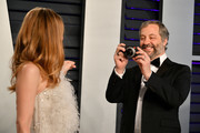 Leslie Mann (L) and Judd Apatow attend the 2019 Vanity Fair Oscar Party hosted by Radhika Jones at Wallis Annenberg Center for the Performing Arts on February 24, 2019 in Beverly Hills, California.
