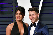 Priyanka Chopra (L) and Nick Jonas attend the 2019 Vanity Fair Oscar Party hosted by Radhika Jones at Wallis Annenberg Center for the Performing Arts on February 24, 2019 in Beverly Hills, California.