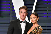 Miles Teller and Keleigh Sperry attend the 2019 Vanity Fair Oscar Party hosted by Radhika Jones at Wallis Annenberg Center for the Performing Arts on February 24, 2019 in Beverly Hills, California.