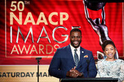 (L-R) Winston Duke and Logan Browning announce the NAACP Image Awards Nominations during the TV One/CleoTV segment of the 2019 Winter Television Critics Association Press Tour at The Langham Huntington, Pasadena on February 13, 2019 in Pasadena, California.