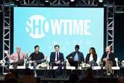 (L-R) Jordan Cahan, David Caspe, Andrew Rannells, Don Cheadle, Regina Hall and Paul Scheer of the television show 'Black Monday' speak during the Showtime segment of the 2019 Winter Television Critics Association Press Tour at The Langham Huntington, Pasadena on January 31, 2019 in Pasadena, California.