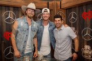 (EDITORIAL USE ONLY. NO COMMERCIAL USE) (L-R) Brian Kelley and Tyler Hubbard of Florida Georgia Line and Steve Wazz pose backstage at the 2019 iHeartCountry Festival Presented by Capital One at the Frank Erwin Center on May 4, 2019 in Austin, Texas.